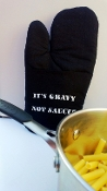 """It's Gravy, Not Sauce!"" black oven mitt"